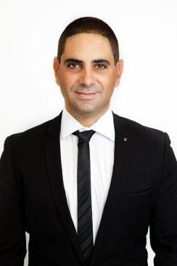 John Amiradakis